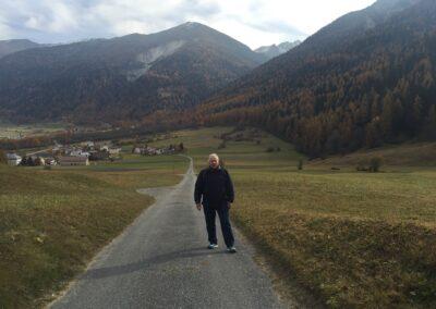 62. JC walking on road Tschierv